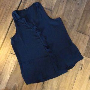 Navy blue ruffled sleeveless blouse.